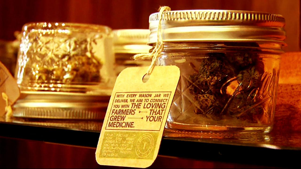 Marijuana is shown in a mason jar at a dispensary.