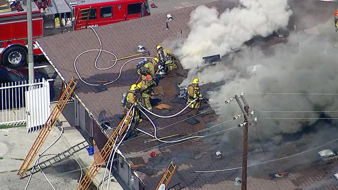 Crews battle a fire at in apartment building in the 500 block of N. Wilmington Boulevard in Wilmington on Friday, April 21, 2017.