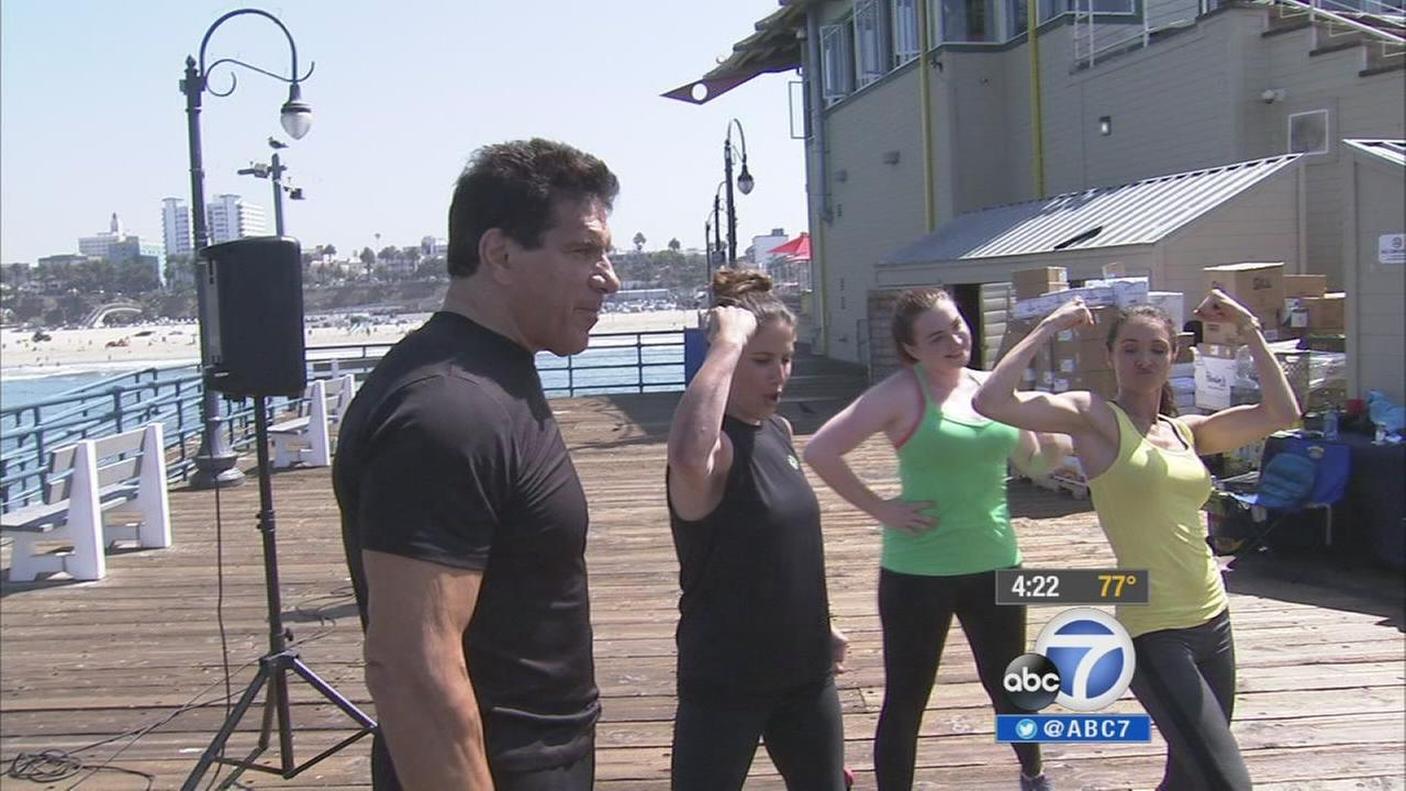 Lou Ferrigno, the original Hulk, and his family offer a free workout program on the Santa Monica Pier.