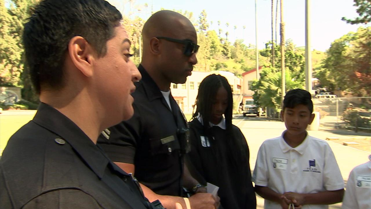 Middle school students and LAPD officers were given the opportunity to step into each others shoes in a program that has its roots in the 1992 Los Angeles riots.