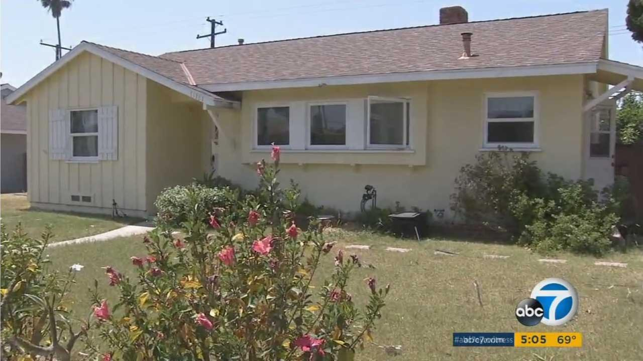 A woman was stabbed to death near this home in a Garden Grove neighborhood.