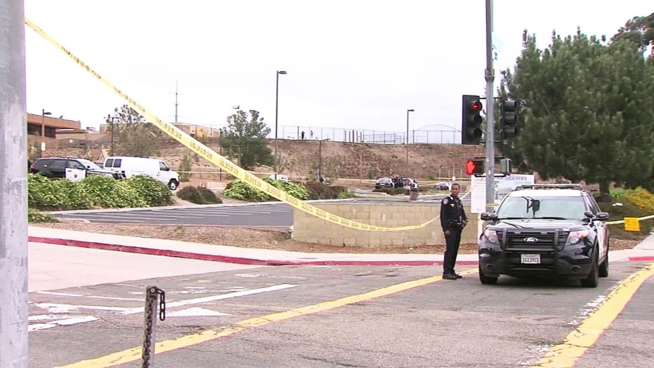 A San Diego police officer patrols an area of Torrey Pines High School, where a 15-year-old boy was shot and killed by police on Saturday, May 6, 2017.