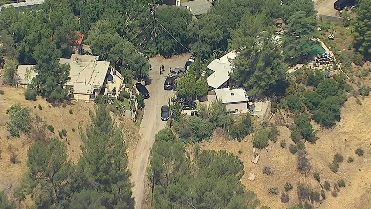 Authorities blocked off a home as a suspect remained inside in the 11300 block of Alethea Drive in Sunland-Tujunga on Monday, May 8, 2017.