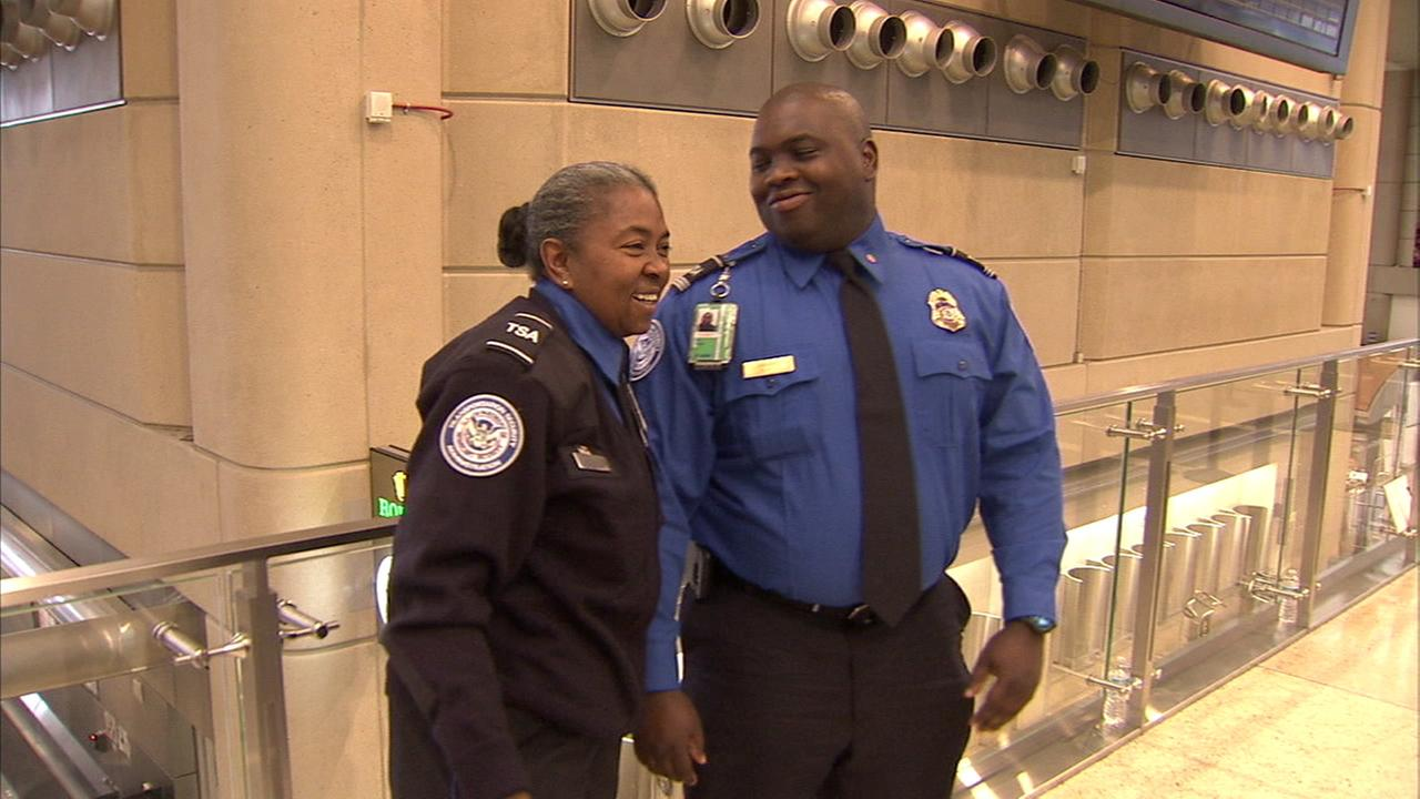 Transportation Security Administration Officer Faye May and her son, Officer Tony Grigsby, are seen at Los Angeles International Airport.