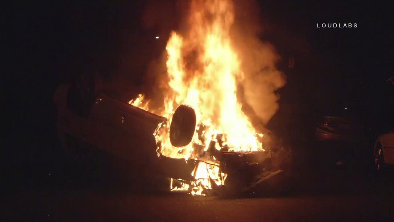 Flames engulf an overturned SUV after a crash on a street in Van Nuys on Thursday, May 11, 2017.