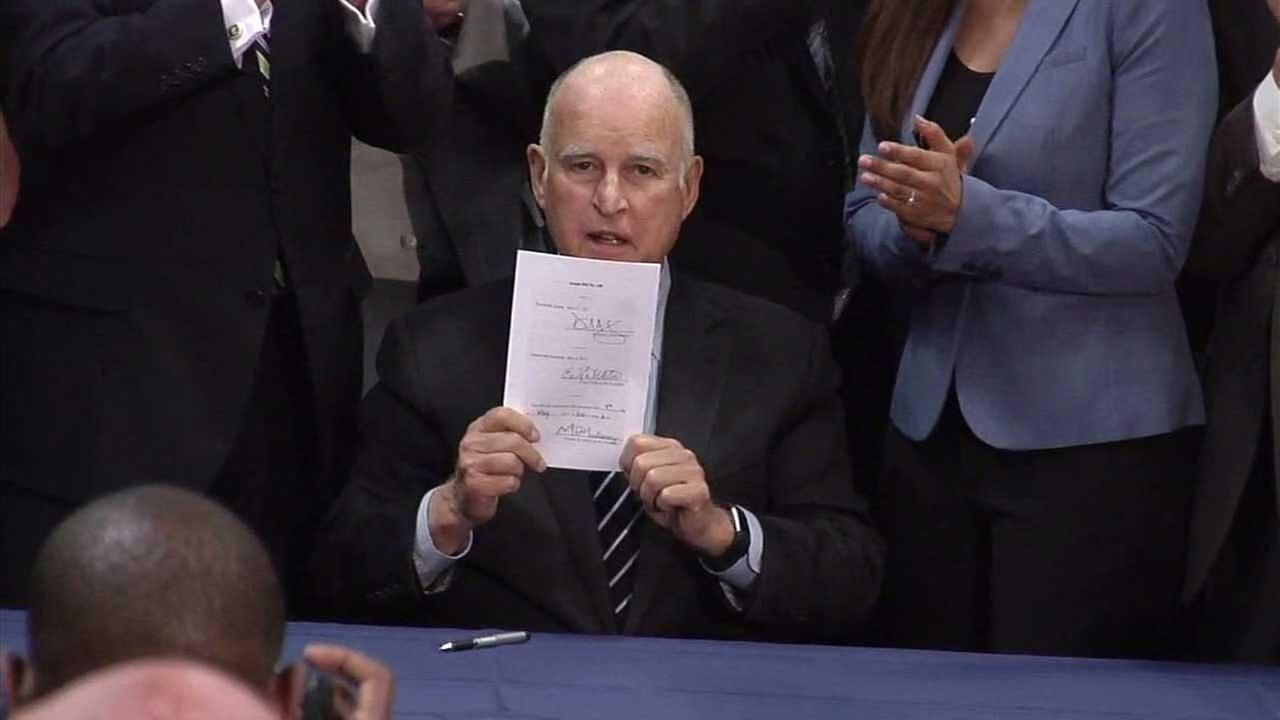 Gov. Jerry Brown signs Senate Bill 130 on Friday, May 12, 2017.