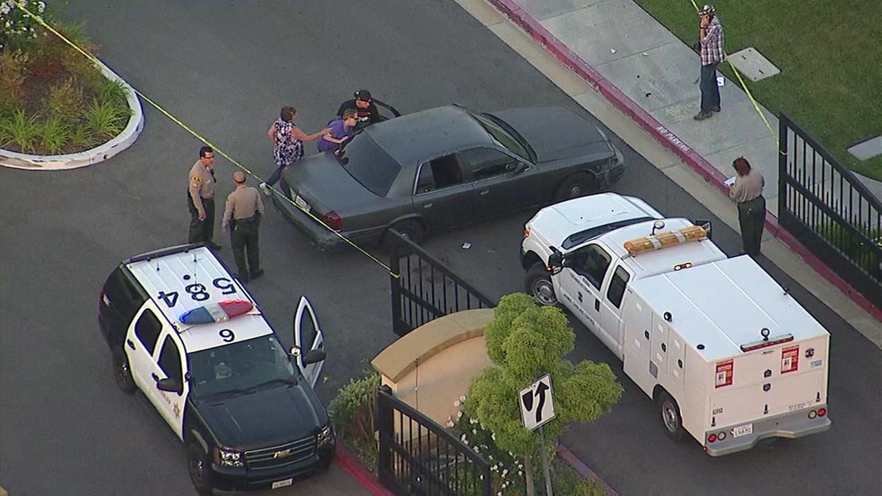 Deputies said an off-duty FBI agent shot and killed a pit bull that attacked his dog near Piazza Di Sarro and Sierra Highway in Newhall on Friday, May 12, 2017.