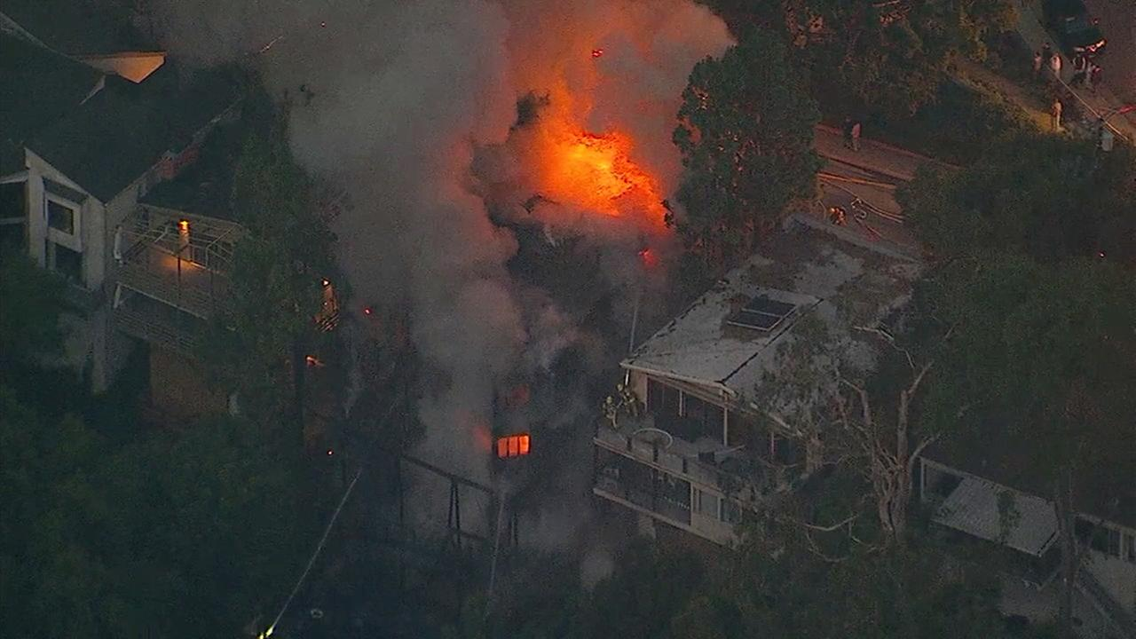 Firefighters responded to a dramatic fire at a multi-story home in Pacific Palisades on Wednesday, May 17, 2017.