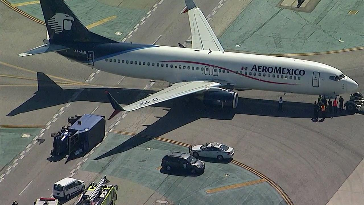 An Aeromexico flight is on a taxiway after it landed and struck a utility truck, injuring workers onboard, at Los Angeles International Airport on Saturday, May 20, 2017.