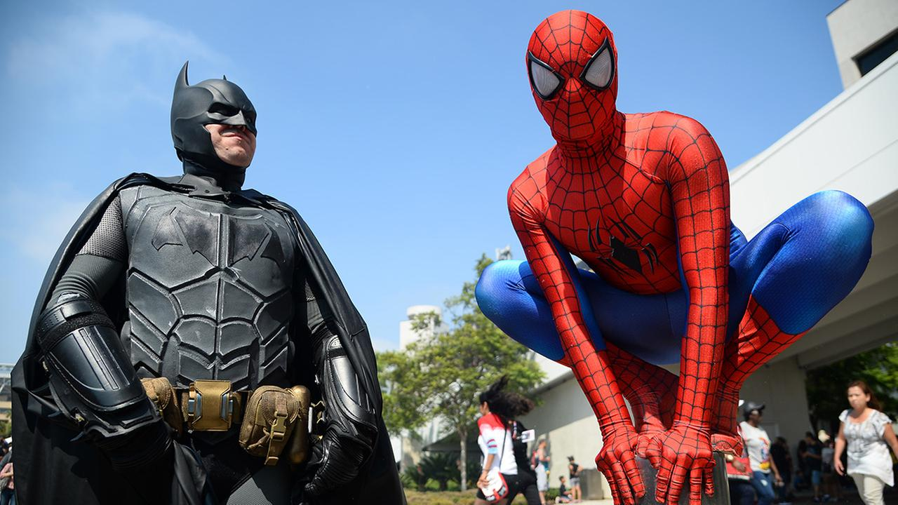 Dorian Black, left, dressed as Batman and Kyle Blankenfield as Spiderman on day 3 of Comic-Con International on Saturday, July 23, 2016, in San Diego.