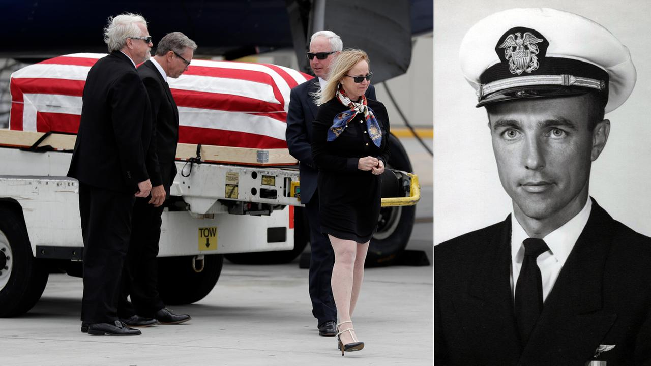 Deborah Crosby, daughter of Lt. Commander Frederick P. Crosby, walks away from her fathers casket after its arrival to the airport Friday, May 26, 2017, in San Diego.