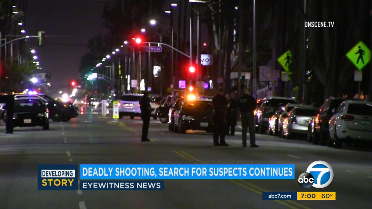 Police closed off part of a street in South Los Angeles after two men were shot and killed Saturday, May 27, 2017.