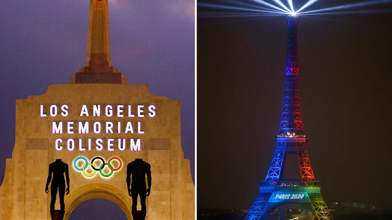 The Los Angeles Memorial Coliseum (left) pictured in a 2008 file photo would be a likely venue for a 2028 LA Olympics, while Paris would host the 2024 games under a pending deal.