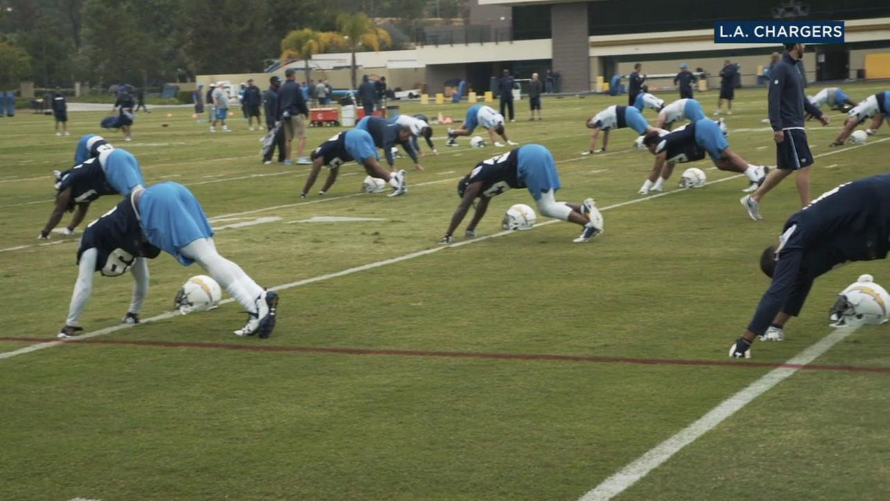Los Angeles Chargers players are shown during a practice.