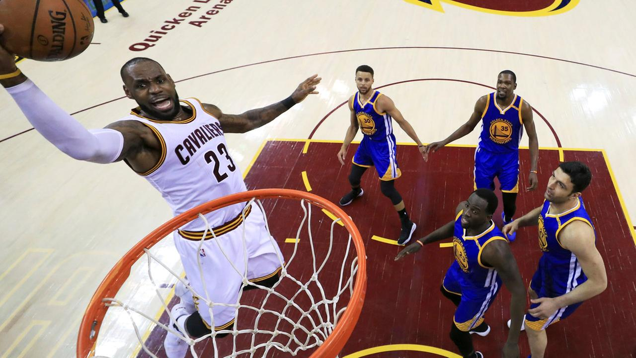 Cleveland Cavaliers forward LeBron James drives to the basket against the Golden State Warriors during the first half of Game 3 of basketballs NBA Finals in Cleveland.