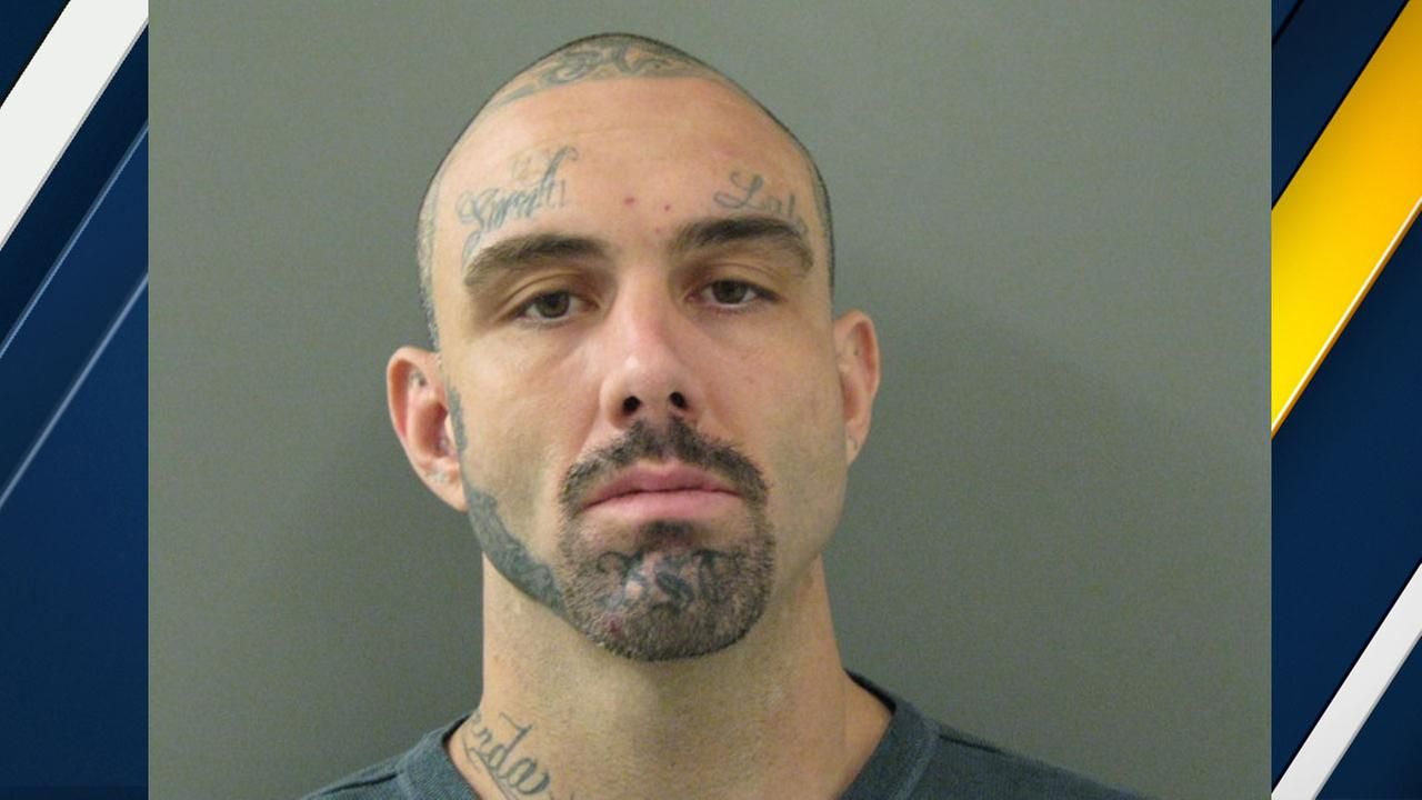 Jack Albert Davis, 32, of Azusa, is shown in a mugshot.
