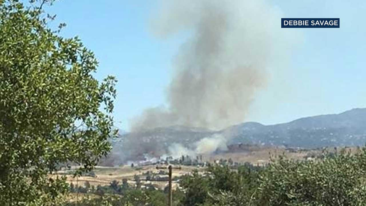 Smoke rises from a vegetation fire in an unincorporated area of Temecula on Tuesday, June 13, 2017.