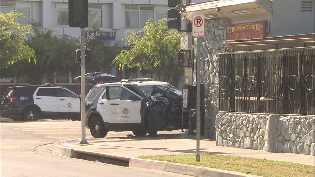 A crushed LAPD SUV is shown in a photo after a teenage cadet is suspected of stealing it and crashing it in South Los Angeles.