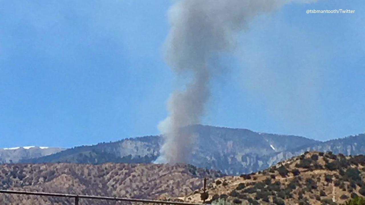 Smoke is seen in the sky from a brush fire burning in the Wrightwood area on Saturday, June 17, 2017.