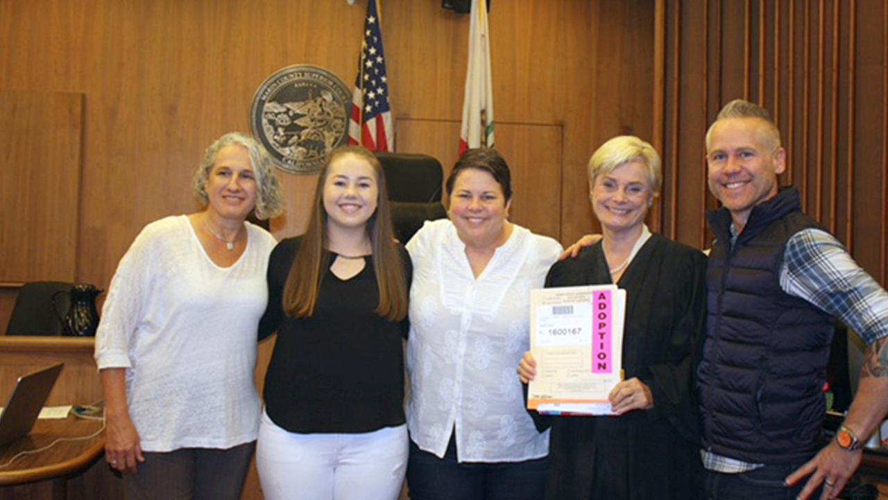 In this October 2016 photo provided by Lin Repola, Victoria Bianchi, left, commemorates the adoption that made her officially the third parent of daughter Madison Bonner-Bianchi.