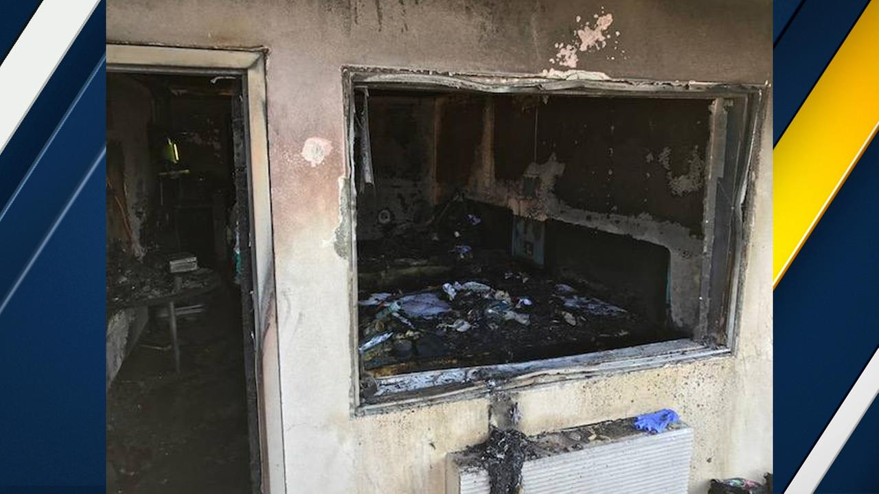 A burned-out motel room is seen after a fire in South El Monte on June 18, 2017.