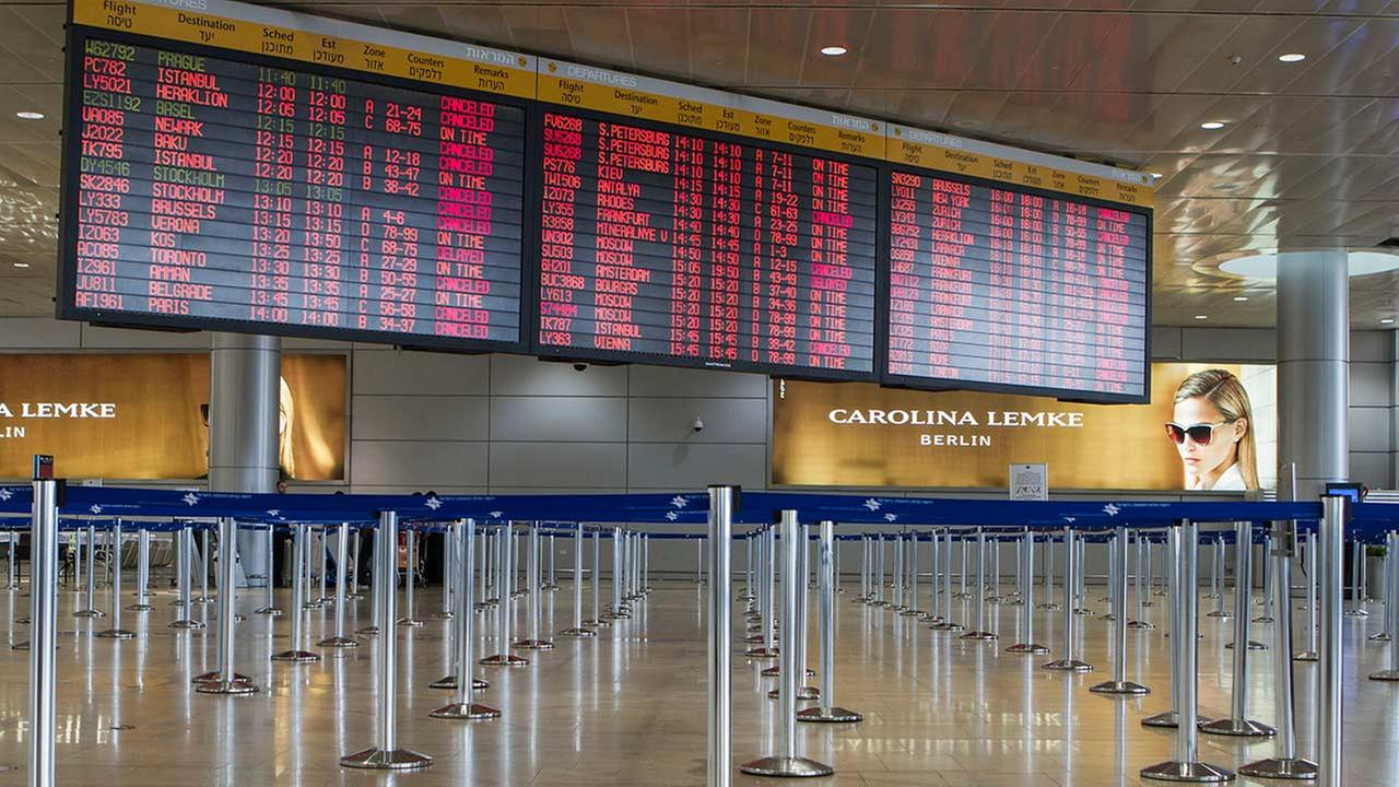 A departure flight board displays canceled and delayed flights in Ben Gurion International airport after the FAA imposed a restriction on flights there, July 23, 2014.