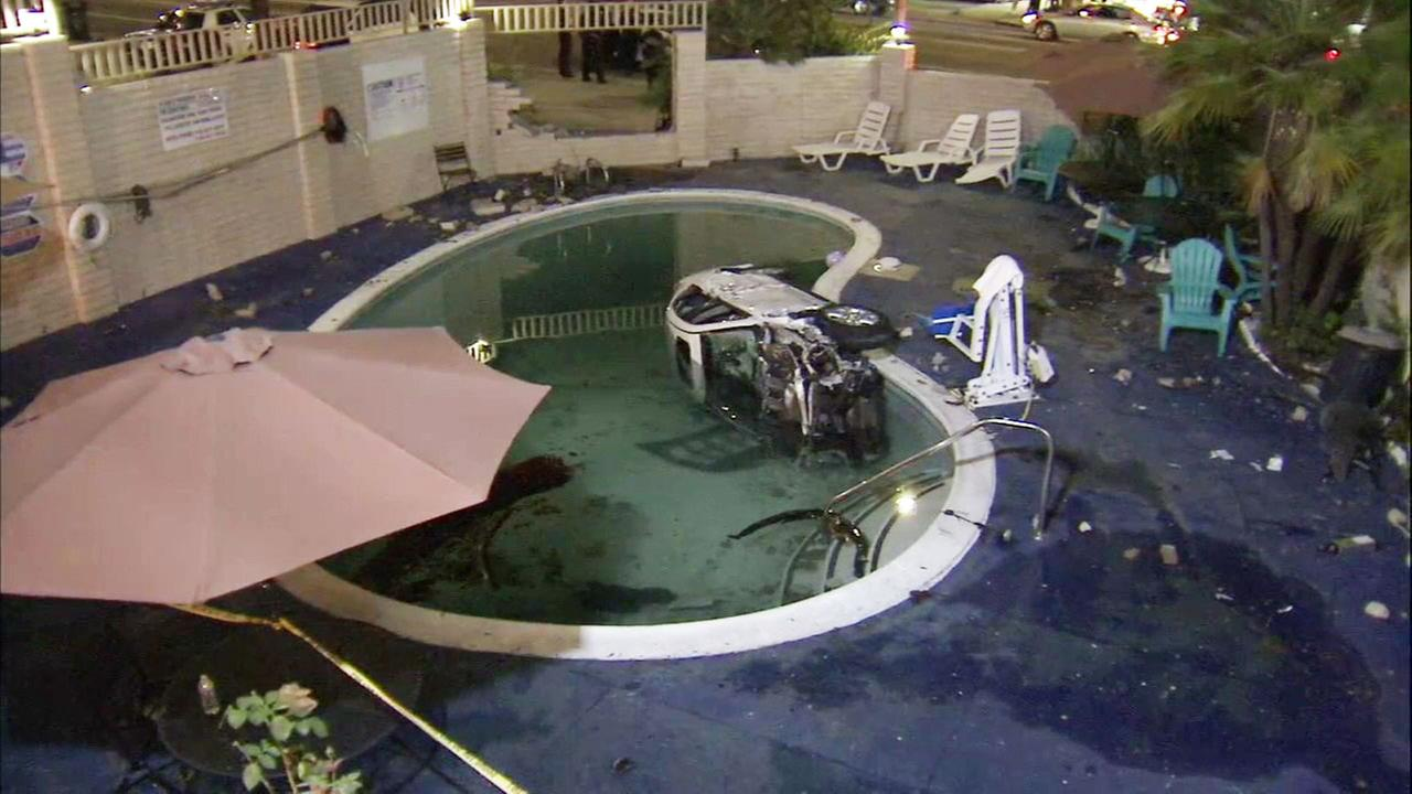 Eight people were injured Sunday, June 25, 2017, after an SUV crashed into a motel swimming pool in San Pedro.