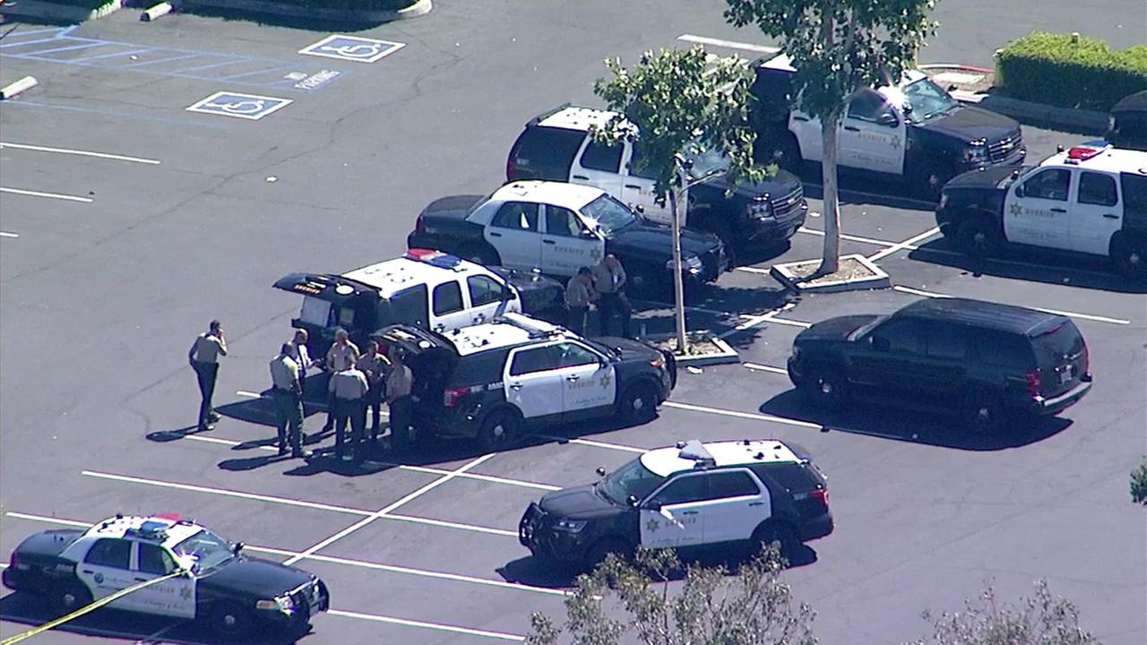 Sheriffs deputies are seen in the parking lot of a Stevenson Ranch shopping center during a standoff with an assault suspect on Tuesday, June 27, 2017.
