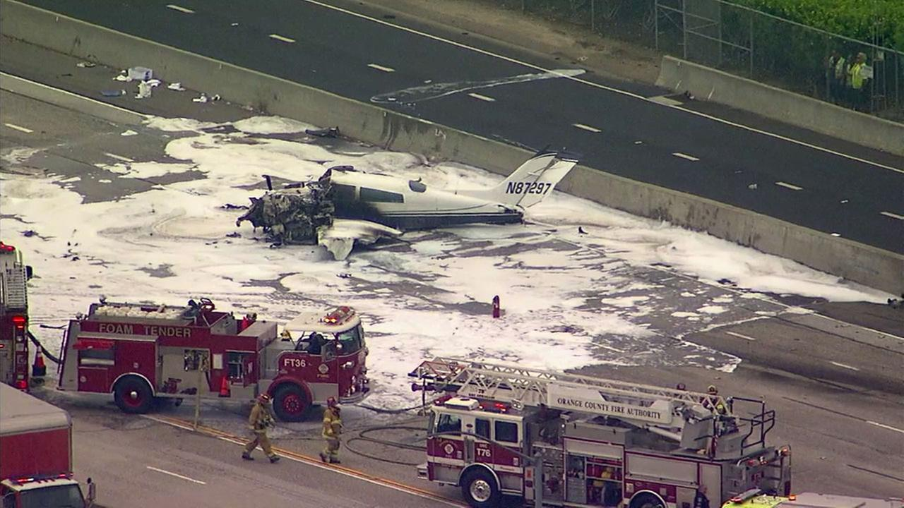 A twin-engine Cessna 310 seen partially mangled and burned after it crashed down on the 405 Freeway in Orange County on Friday, June 30, 2017.