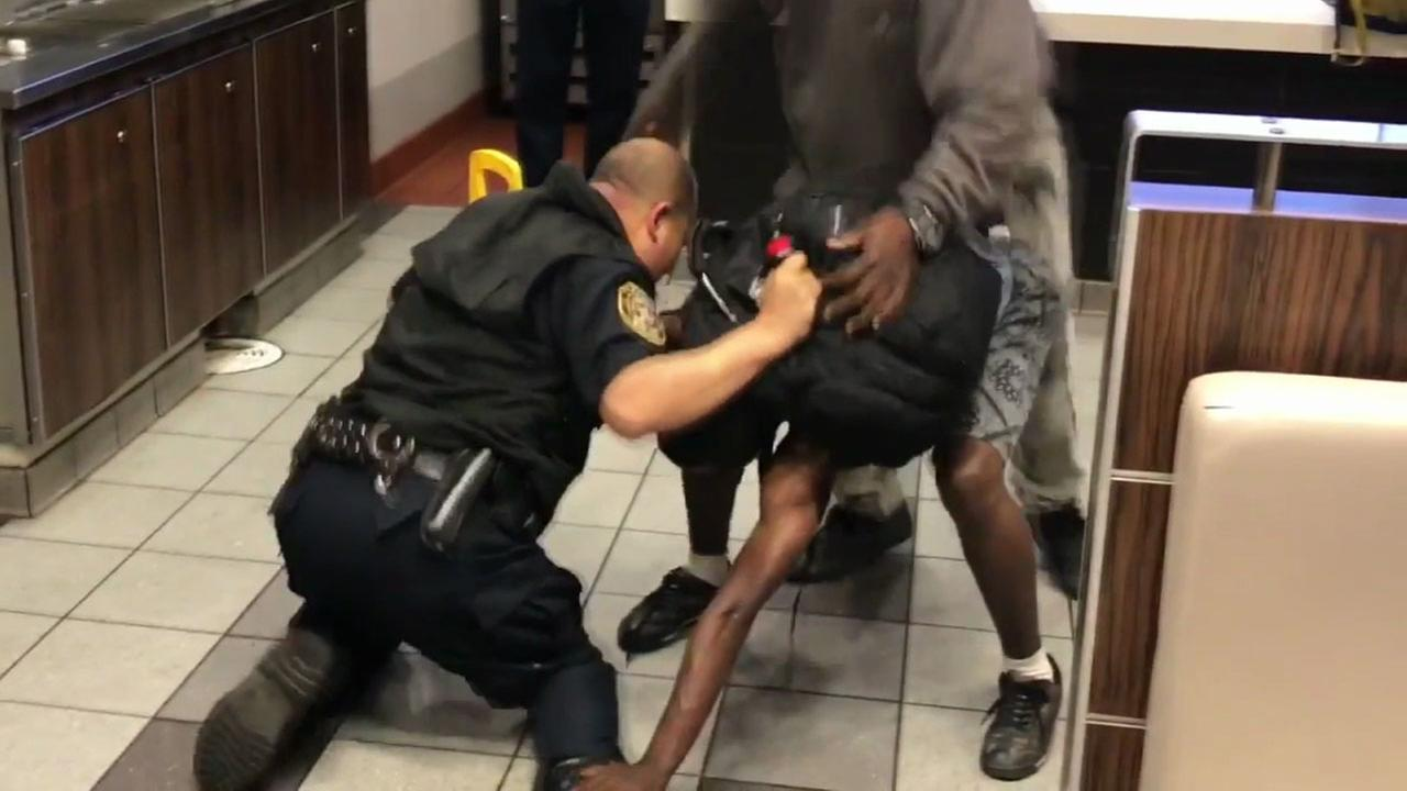 A security guard and man fight inside a Santa Monica McDonalds in the early morning hours of Wednesday, July 5, 2017.