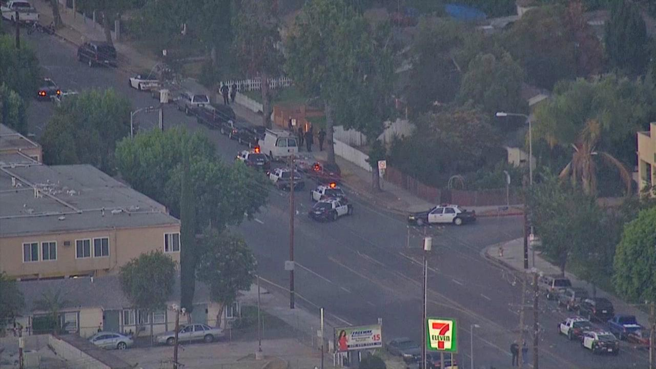 Authorities investigate an officer-involved shooting in the Lake Balboa area on Friday, July 25, 2014.