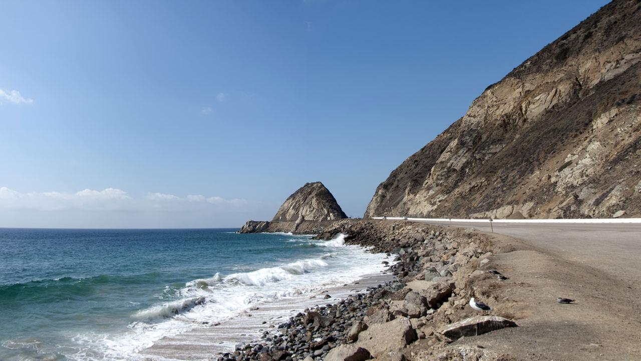 Point Mugu rock is shown in a stock photo.