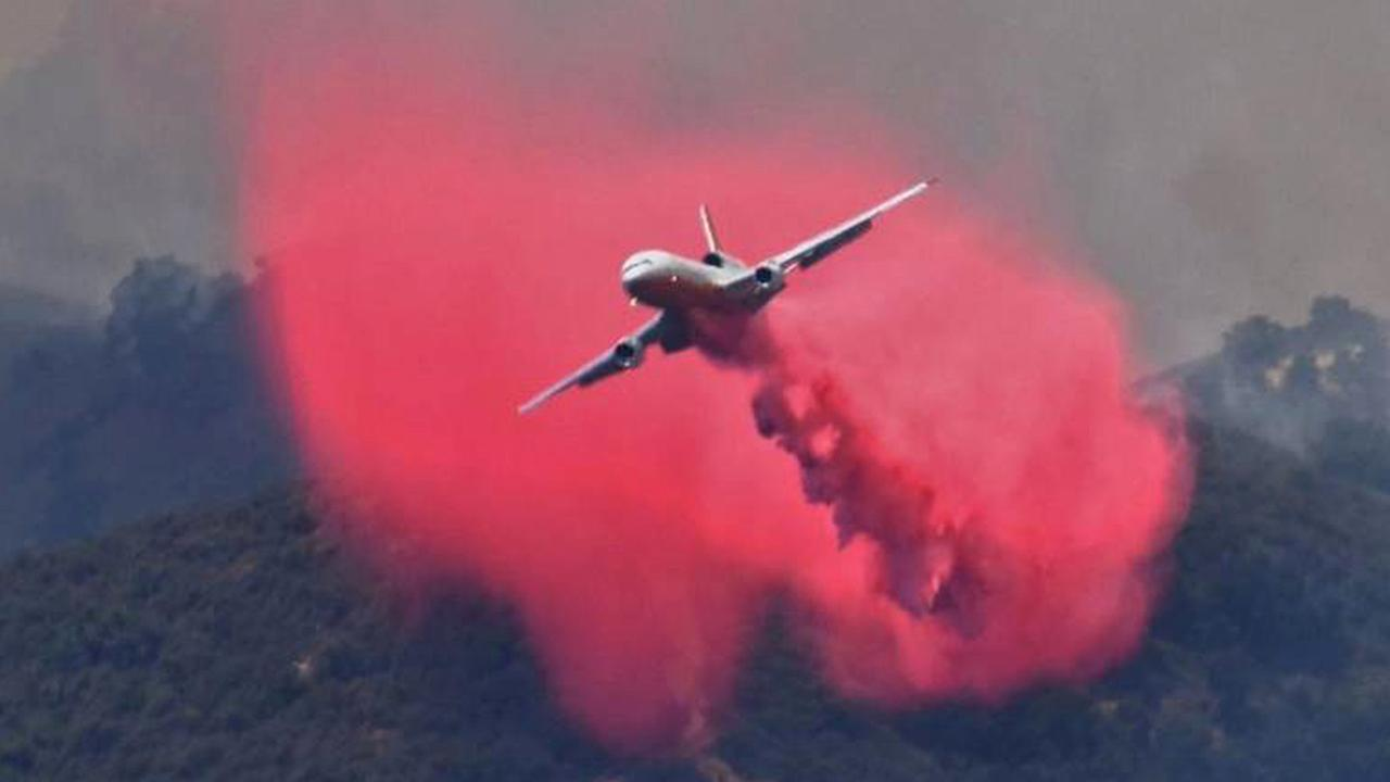A DC-10 makes a fire retardant drop on a ridge line along the eastern flank of the Alamo Fire in Santa Barbara County on Saturday, July 8, 2017.