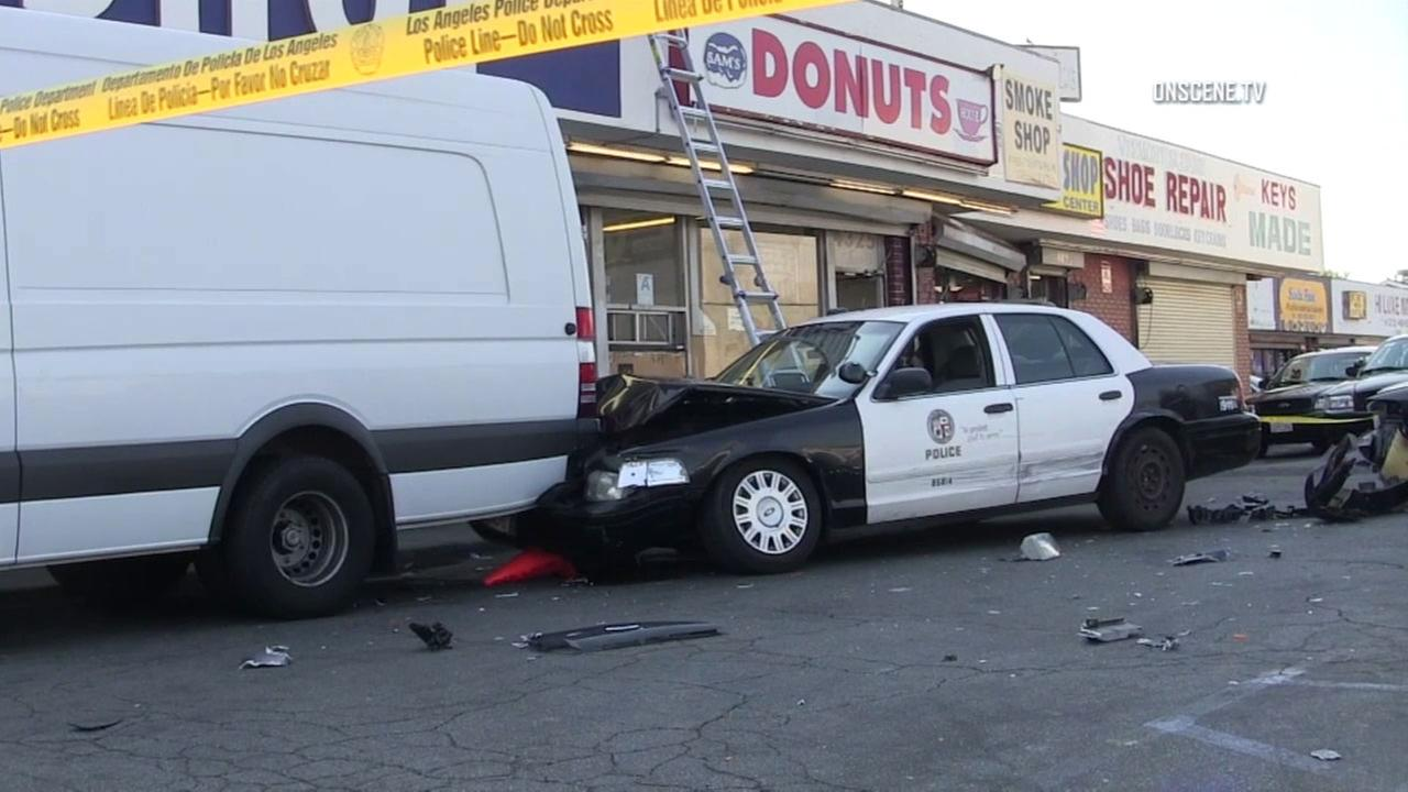 Two LAPD cruisers were involved in a crash and struck a parked vehicle at a strip mall in South Los Angeles on Monday, July 17, 2017.