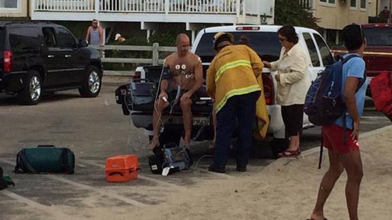 Emergency crews treat a scuba diver who was revived after being hit by lightning in Venice Beach on Sunday, July 27, 2014.