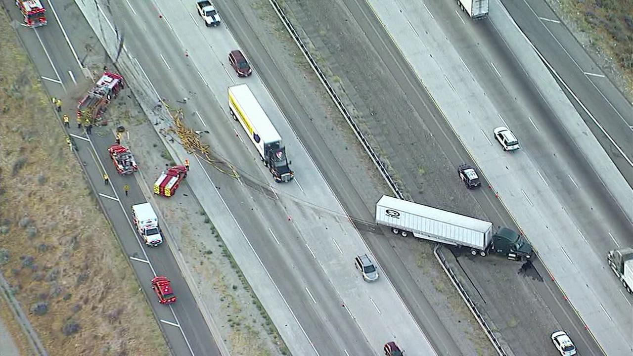 A tractor-trailer and a Los Angeles County Fire Department engine are seen after they collided with each other on the 5 Freeway in Gorman on Tuesday, July 25, 2017.