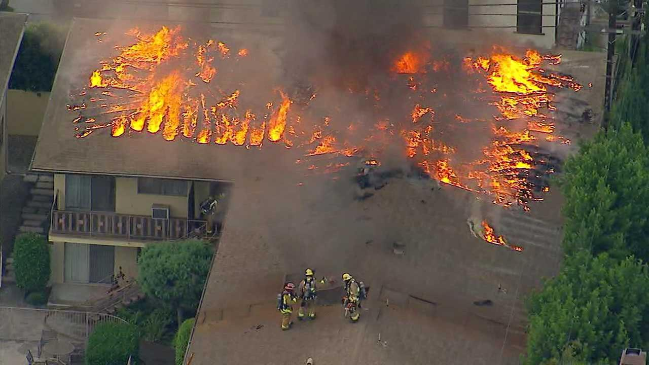 Firefighters battle a fire at an apartment complex in Arcadia on Thursday, Aug. 3, 2017.