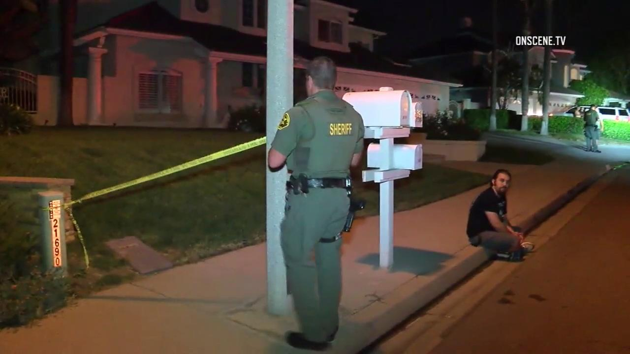 An Orange County Sheriffs Department deputy cordoned off a crime scene a shooting at a home in Yorba Linda on Wednesday, Aug. 2, 2017.