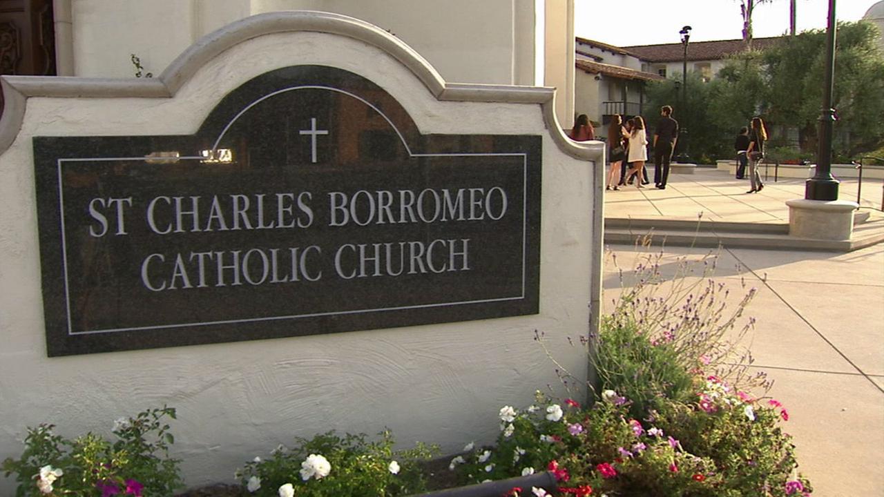 A sign for St. Charles Borromeo Catholic Church is shown.