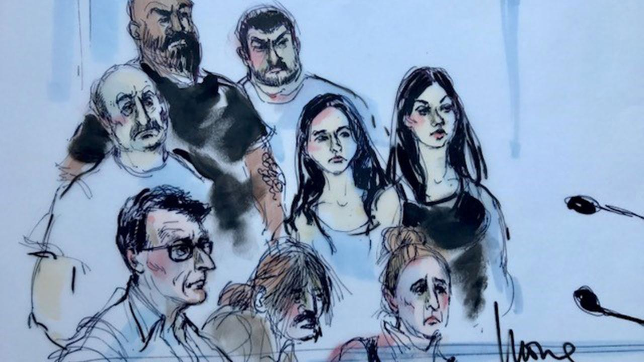 Eight of the dozen defendants charged with operating sham medical clinics appear in a Los Angeles courtroom on Thursday, Aug. 3, 2017.