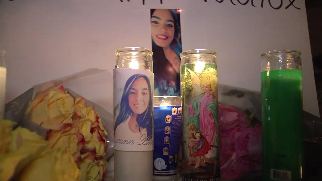 People placed flowers, candles and photos of a 28-year-old woman who was shot and killed in Montebello.