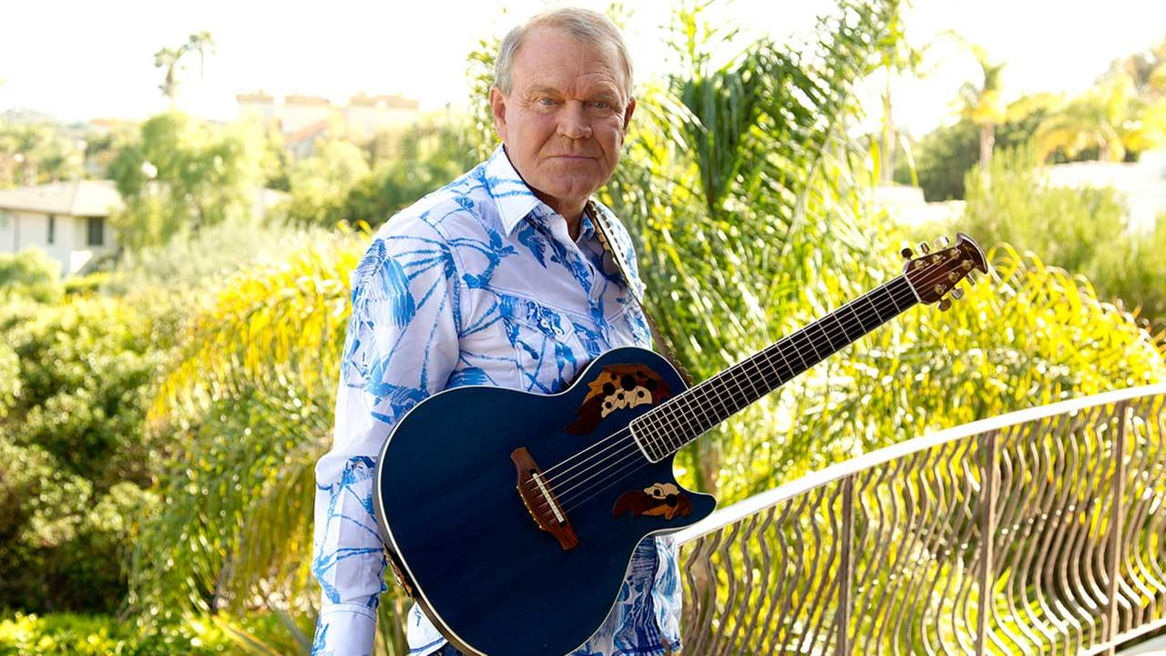In this July 27, 2011 photo, musician Glen Campbell poses for a portrait in Malibu, California.