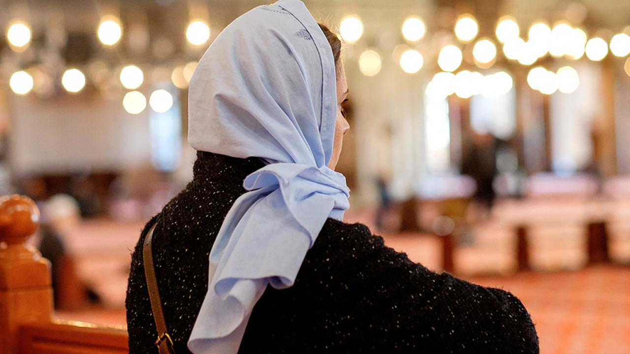 A woman wears a headscarf in this undated file image.