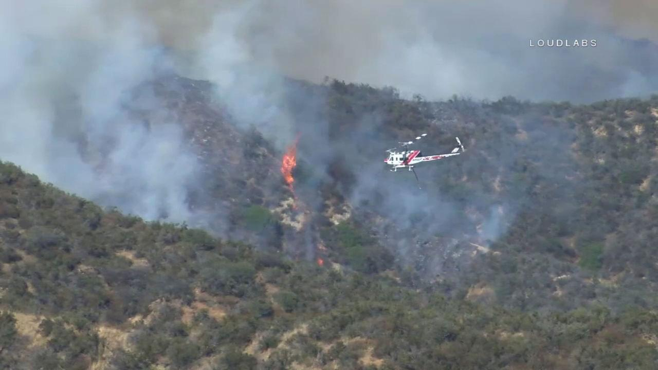 Firefighters were battling a brush fire in Banning that charred at least 150 acres on Monday, Aug. 14, 2017.