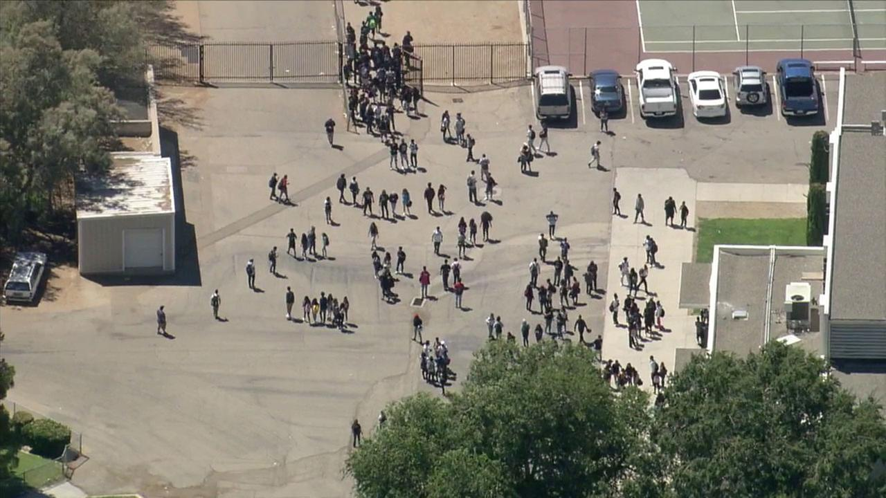 A swarm of bees stung about 40 students at Palmdale High School - sending 35 to the hospital - after someone apparently threw an apple at their hive, officials said.