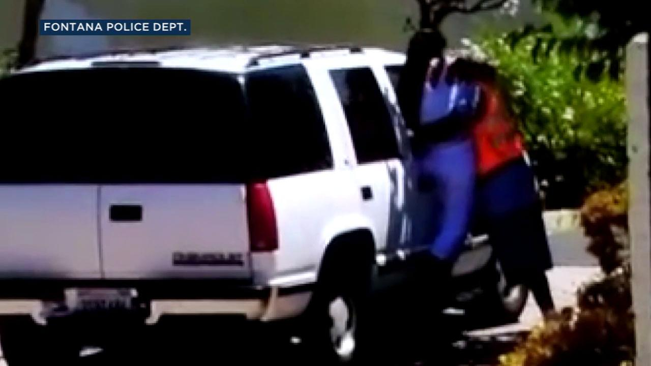 Cellphone video shows what appears to be a man forcing a woman into his car in Fontana on Wednesday, Aug. 16, 2017.