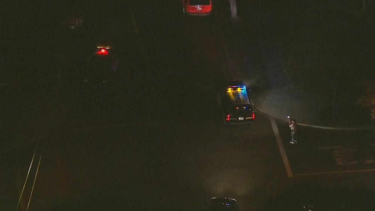 Authorities investigate a shooting in Rossmoor on Thursday, July 31, 2014.
