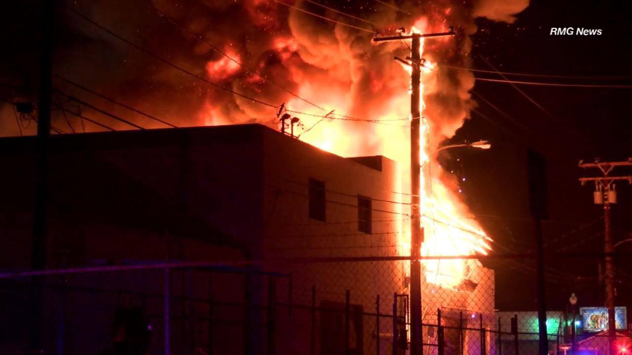 Flames rip through an auto body shop in Montebello on Wednesday, Aug. 23, 2017.