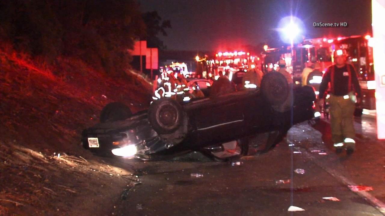 Authorities investigate a deadly crash on the westbound 10 Freeway in the Palms area on Sunday, Aug. 3, 2014.