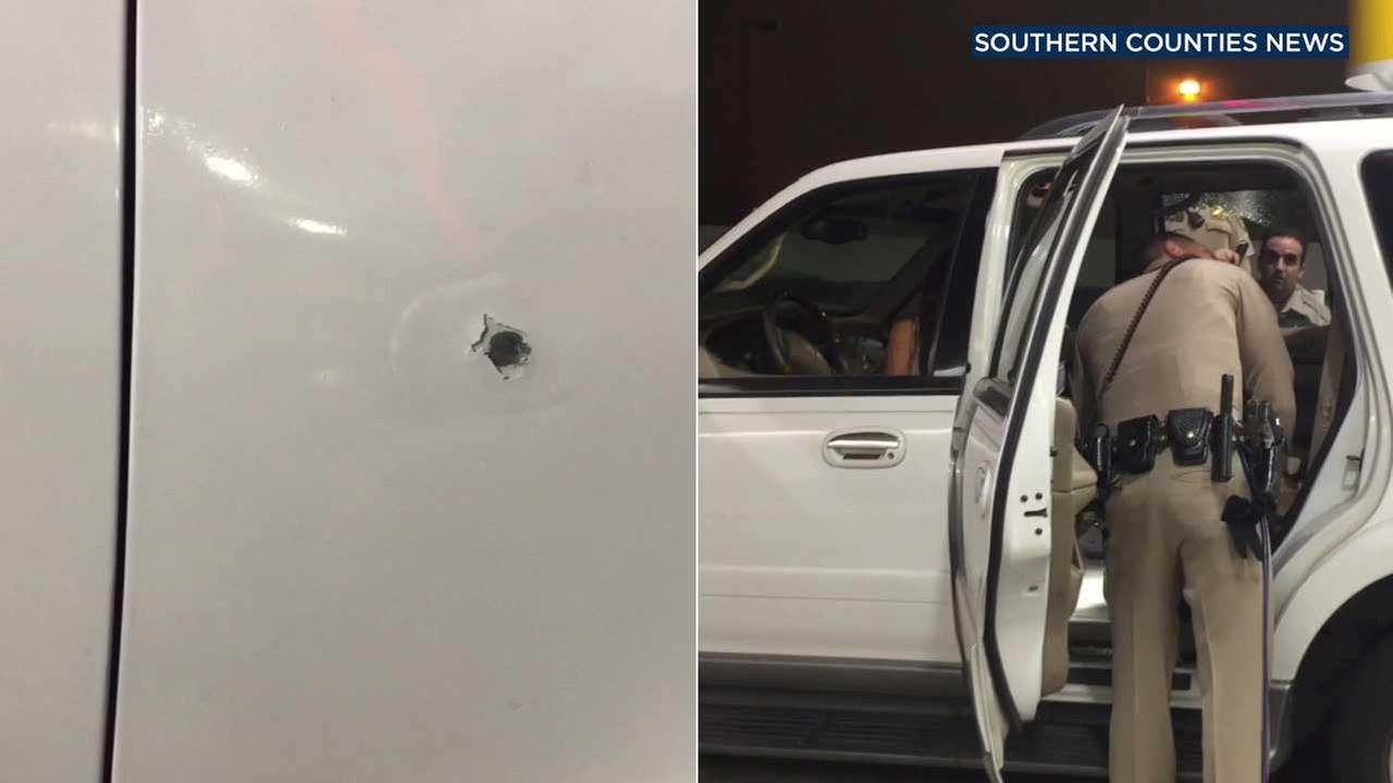 A bullet hole is seen on an SUV driven by a woman who police say was fired upon by her husband along the 91 Freeway on Friday, Sept. 1, 2017.
